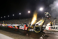 Sep 13, 2013; Charlotte, NC, USA; NHRA top fuel dragster driver David Grubnic during qualifying for the Carolina Nationals at zMax Dragway. Mandatory Credit: Mark J. Rebilas-