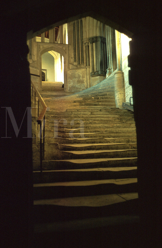 Stone stairs leading through an archway to the Chapter House of the 12th Century English Cathedral. England, Wells Cathedral.