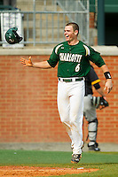 Brett Lang (6) of the Charlotte 49ers flips his batting helmet as he heads towards home plate after hitting a walk-off solo home run on the first pitch in the bottom of the 9th inning against the Virginia Commonwealth Rams at Robert and Mariam Hayes Stadium on March 30, 2013 in Charlotte, North Carolina.  The 49ers defeated the Rams 9-8 in game one of a double-header.  (Brian Westerholt/Four Seam Images)