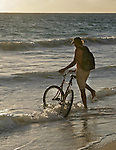 A man and his bike on a windy beach in Kailua, Hawaii.