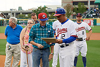 Buffalo Bisons manager Bob Meacham (12) is presented a cutting board from the Booster Club before a game against the Pawtucket Red Sox on August 31, 2017 at Coca-Cola Field in Buffalo, New York.  Buffalo defeated Pawtucket 4-2.  (Mike Janes/Four Seam Images)