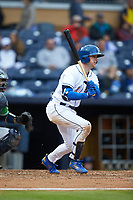 Jake Cronenworth (1) of the Durham Bulls follows through on his swing against the Gwinnett Braves at Durham Bulls Athletic Park on April 20, 2019 in Durham, North Carolina. The Bulls defeated the Braves 11-3 in game one of a double-header. (Brian Westerholt/Four Seam Images)