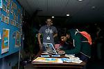 Registering more actions at the 350.org booth for October 24. (©Robert vanWaarden)