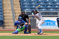Wichita Wind Surge Austin Martin (20) bats in front of catcher Hunter Feduccia (10) and umpire Harrison Silverman during a game against the Tulsa Drillers on August 15, 2021 at ONEOK Field in Tulsa, Oklahoma.  (Mike Janes/Four Seam Images)