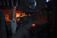Workers operate near the iron smelter at Ma Steel's new plant in Maanshan, China..29 Dec 2008.