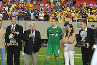 Founder of title sponsor Aaron's, Charlie Loudermilk presents the championship rophy following the match. The 2010 Atlanta International Soccer Challenge was held, Wednesday, July 28, at the Georgia Dome, featuring a match between Club America and Manchester City. After regulation time ended 1-1, Manchester City was awarded the victory, winning 4-1, in penalty kicks.