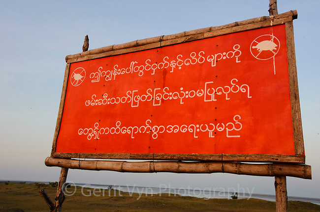 """Sign saying """"No hunting and killing birds and turtles on Nan Thar Island"""". This is a major wintering site for the critically endangered Spoon-billed Sandpiper. Rakhine State, Myanmar. January."""