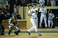 Gavin Sheets (24) of the Wake Forest Demon Deacons follows through on his game winning single to right center field in the bottom of the ninth inning against the West Virginia Mountaineers in Game Four of the Winston-Salem Regional in the 2017 College World Series at David F. Couch Ballpark on June 3, 2017 in Winston-Salem, North Carolina.  The Demon Deacons walked-off the Mountaineers 4-3.  (Brian Westerholt/Four Seam Images)