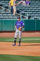 Josh Fuentes (7) of the Albuquerque Isotopes on defense against the Salt Lake Bees at Smith's Ballpark on April 27, 2019 in Salt Lake City, Utah. The Isotopes defeated the Bees 10-7. This was a makeup game from April 26, 2019 that was cancelled due to rain. (Stephen Smith/Four Seam Images)