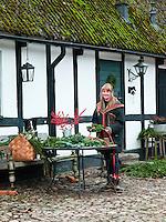 Lena Brandsten making Christmas wreathes in her garden in Skåne