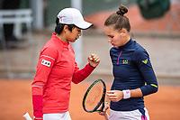 2nd October 2020, Roland Garros, Paris, France; French Open tennis, Roland Garros 2020;  Zhang Shuai R and Veronika Kudermetova react during the womens doubles second round match against Alison Van Uytvanck/Greet Minnen of Belgium