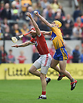 Bill Cooper of Cork in action against Colm Galvin of Clare during their Munster Senior game at Pairc Ui Chaoimh. Photograph by John Kelly.