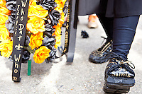 """Melvin Bodenheimer aka """"Little Dempsey"""" shows off his unique footwear at a parade held in Buddy D's honor on January 31, 2010 in New Orleans.<br /> <br /> Thousands of Saints fans wearing dresses paraded from the Louisiana Superdome to the French Quarter to honor a promise made by the late sportscaster and Saints super-fan Buddy Diliberto aka """"Buddy D"""".<br /> <br /> In 1993 Buddy D, who passed away in 2005, remarked on air that if the Saints were to make it to the Super Bowl, he would wear a dress and dance down the streets.  The comment was repeated at various times and never forgotten by his listeners.<br /> <br /> Led by former New Orleans Saints quarterback Bobby Hebert, who has taken Buddy D's place on WWL radio, thousands made good on his promise for him, dancing, drinking, and cavorting their way down the street, alternately yelling out """"Who Dat!"""" and """"Buddy D!"""" in front of an onlooking crowd an estimated 85,000 people strong.<br /> <br /> The hard luck NFL team the New Orleans Saints has reached its first Super Bowl in team history, after 43 years largely filled with losing seasons and futility.  It is difficult to travel anywhere in the area without some reminder of this fact, as the team and city are intertwined perhaps like no other sports franchise in this country."""