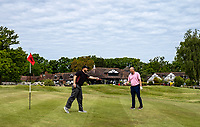 The usual end of game handshake is replaced with club tapping. Covid-19 Golf phased exit at Hever Castle Golf club, Edenbridge, England on 17 May 2020. Photo by Liam McAvoy.<br /> <br /> Hever Castle Golf club opened its golf course on May 13, 2020 in Edenbridge, Kent.<br /> Golf courses reopen in England under government guidelines after Prime Minister Boris Johnson announced the general contours of a phased exit from the current lockdown.