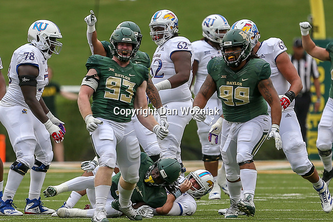 Baylor Bears defensive tackle James Lynch (93)and Baylor Bears defensive tackle Bravvion Roy (99) in action during the game between the Kansas Jayhawks and the Baylor Bears at the McLane Stadium in Waco, Texas.