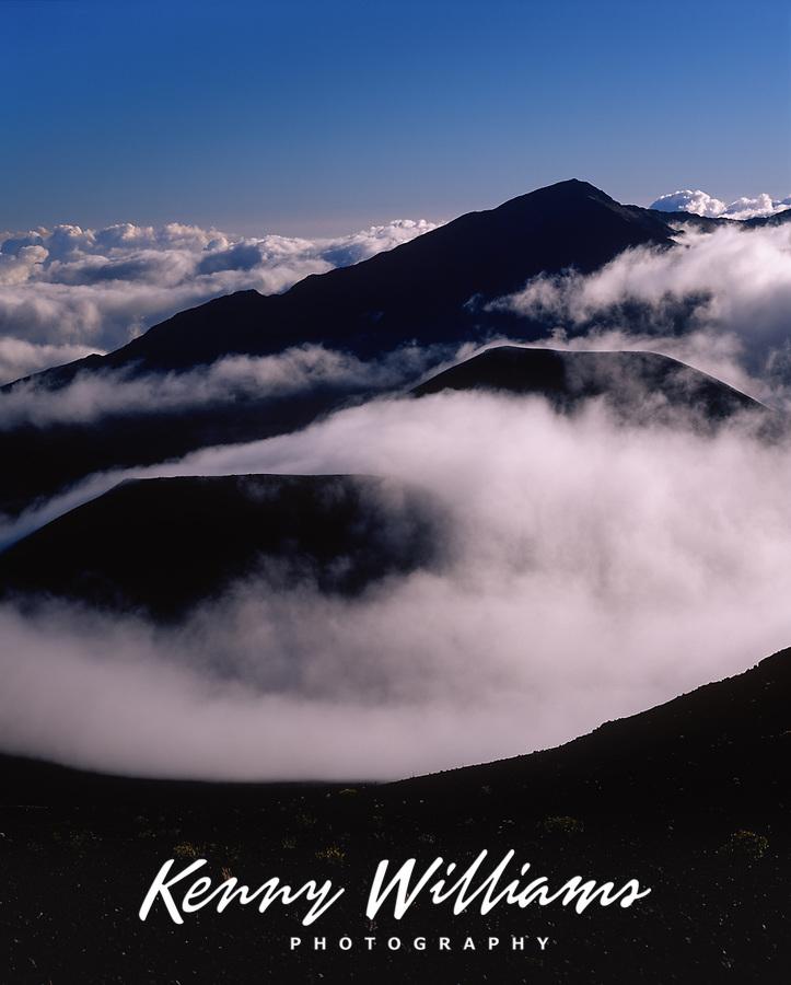 Clouds Engulfing Volcanic Cinder Cones, Haleakala National Park, Maui, Hawaii, USA.