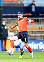 21st November 2020; Kenilworth Road, Luton, Bedfordshire, England; English Football League Championship Football, Luton Town versus Blackburn Rovers; Sonny Bradley of Luton Town breaking past a challenge from Adam Armstrong of Blackburn Rovers
