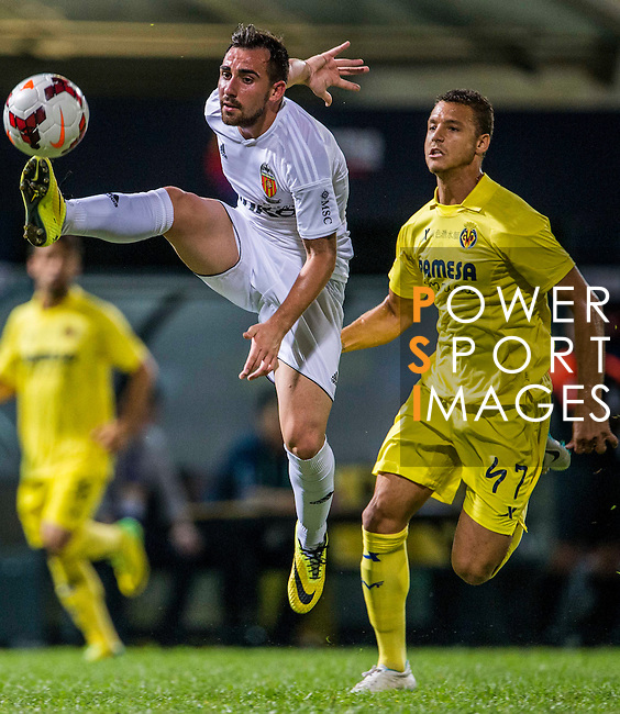 (L) Paco Alcacer of Valencia CF competes for the ball with (R) LFP World Challenge 2014 between Valencia CF vs Villarreal CF on May 28, 2014 at the Mongkok Stadium in Hong Kong, China. Photo by Victor Fraile / Power Sport Images