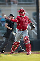 Lakewood BlueClaws catcher Deivi Grullon (4) makes a throw to first base against the Kannapolis Intimidators at Kannapolis Intimidators Stadium on May 10, 2016 in Kannapolis, North Carolina.  The BlueClaws defeated the Intimidators 5-3.  (Brian Westerholt/Four Seam Images)