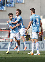 Calcio, Serie A: Lazio vs Roma. Roma, stadio Olimpico, 3 aprile 2016.<br /> Lazio's Marco Parolo, left, celebrates with teammates Patric, center, and Wesley Hoedt, after scoring during the Italian Serie A football match between Lazio and Roma at Rome's Olympic stadium, 3 April 2016. Roma won 4-1.<br /> UPDATE IMAGES PRESS/Isabella Bonotto