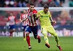 Angel Correa (R) of Atletico de Madrid competes for the ball with Vitorino Gabriel Pacheco Antunes of Getafe CF during the La Liga 2017-18 match between Atletico de Madrid and Getafe CF at Wanda Metropolitano on January 06 2018 in Madrid, Spain. Photo by Diego Gonzalez / Power Sport Images