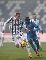 Football: Super Cup Final Juventus vs Napoli at Mapei Stadium in Reggio Emilia, on January 20,  2021.<br /> Juventus' Dejan Kulusevski (l) in action with Napoli Kalidou Coulibaly (r) during the Italian Super Cup Final match between Juventus and Napoli at Mapei Stadium in Reggio Emilia, on January 20,  2021.<br /> UPDATE IMAGES PRESS/Isabella Bonotto