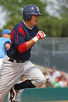 Third baseman Jon Hee of the Salem Red Sox running to first base against  the Myrtle Beach Pelicans on May 3, 2009