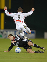 DC United defender Bryan Namoff (26) slides to tackle the ball against Chicago Fire forward Chad Barrett (9). DC United tied The Chicago Fire 0-0, at RFK Stadium in Washington DC, on Saturday October 13, 2007.