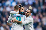 Gareth Bale (C) of Real Madrid celebrates with teammate Karim Benzema and Daniel Carvajal Ramos during the La Liga 2017-18 match between Real Madrid and Deportivo Alaves at Santiago Bernabeu Stadium on February 24 2018 in Madrid, Spain. Photo by Diego Souto / Power Sport Images