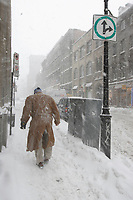 Montreal, March 2nd 2007....A man walk on Notre-Dame street while a..Snow storm hits Montreal......Photo by Pierre Roussel - Images Distribution