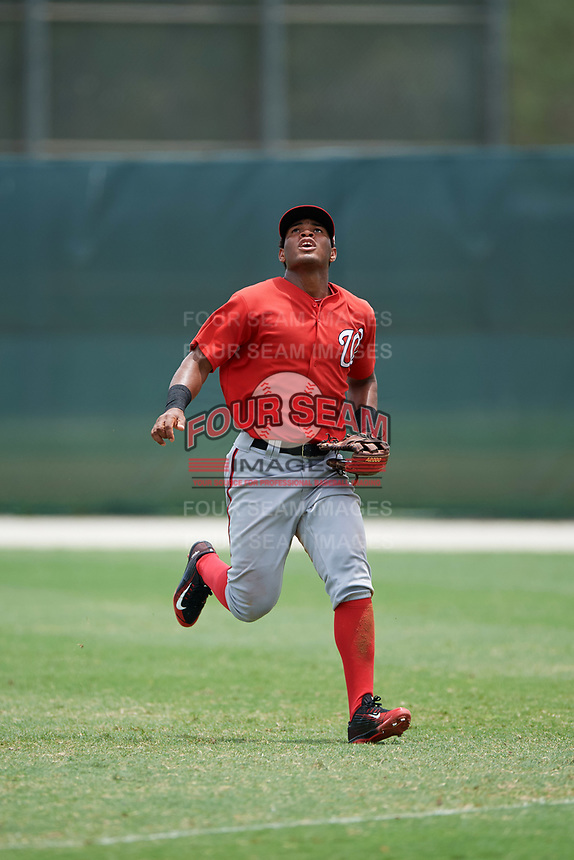 GCL Nationals right fielder Santo Falcon (17) tracks a fly ball during the second game of a doubleheader against the GCL Marlins on July 23, 2017 at Roger Dean Stadium Complex in Jupiter, Florida.  GCL Nationals defeated the GCL Marlins 1-0.  (Mike Janes/Four Seam Images)