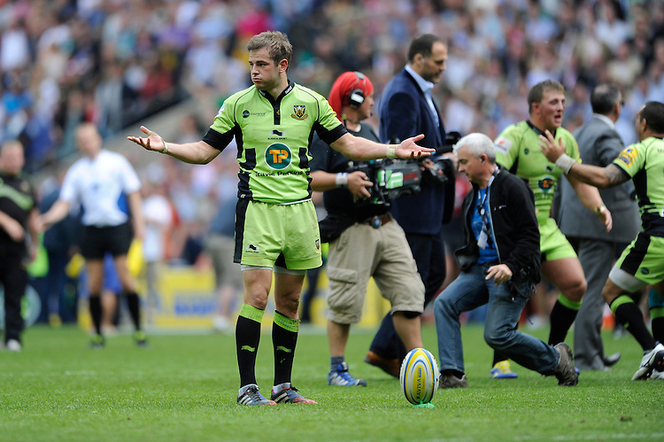 Stephen Myler of Northampton Saints is not sure whether to take the final conversion kick as the pitch is overrun by the media and other players during the Aviva Premiership Final between Saracens and Northampton Saints at Twickenham Stadium on Saturday 31st May 2014 (Photo by Rob Munro)