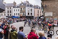 peloton, with Belgian National Champion Wout van Aert (BEL/Jumbo-Visma), rolling through town<br /> <br /> Stage 3 from Lorient to Pontivy (183km)<br /> 108th Tour de France 2021 (2.UWT)<br /> <br /> ©kramon