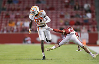 Arkansas linebacker J.T. Towers (17) tries to grab a hold of Tennessee wide receiver Ramel Keyton (80), Saturday, November 7, 2020 during the first quarter of a football game at Donald W. Reynolds Razorback Stadium in Fayetteville. Check out nwaonline.com/201108Daily/ for today's photo gallery. <br /> (NWA Democrat-Gazette/Charlie Kaijo)