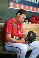 Harrisburg Senators pitcher Matthew Spann (13) preps his glove in the dugout during a game against the New Hampshire Fisher Cats on July 21, 2015 at Metro Bank Park in Harrisburg, Pennsylvania.  New Hampshire defeated Harrisburg 7-1.  (Mike Janes/Four Seam Images)