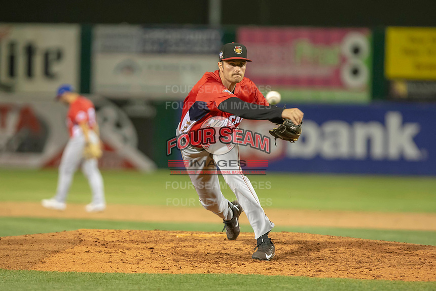 Wyatt Mills (14) of the Modesto Nuts warms up between innings against the South Division during the 2018 California League All-Star Game at The Hangar on June 19, 2018 in Lancaster, California. The North All-Stars defeated the South All-Stars 8-1.  (Donn Parris/Four Seam Images)