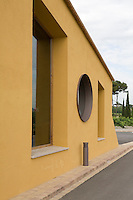The yellow stucco exterior of Can Bonastre, a five star hotel