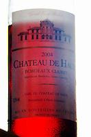 A bottle of Chateau de Haux rose clairet wine backlit Chateau de Haux Premieres Cotes de Bordeaux Entre-deux-Mers Bordeaux Gironde Aquitaine France