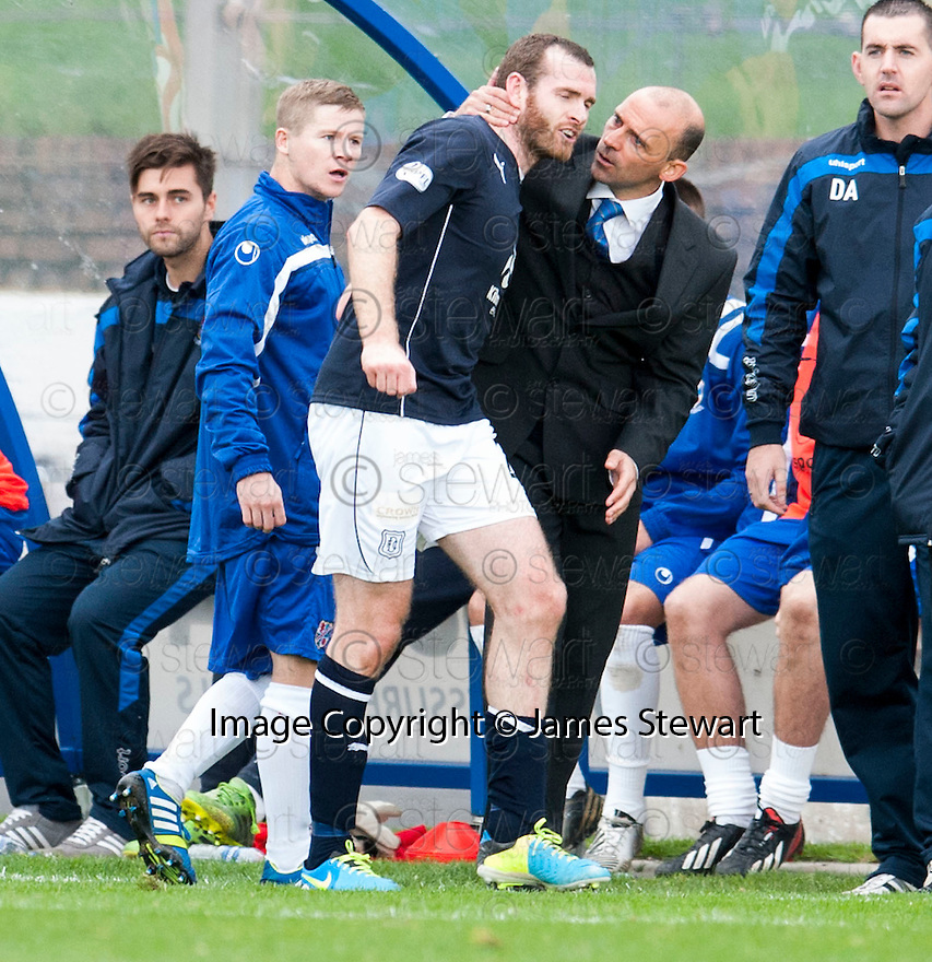 Cowdenbeath manager Colin Cameron pulls away Dundee's Craig Beattie as he and Cowdenbeath's Marc McKenzie have a go at each other in the dug out.