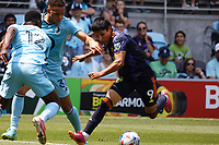ST PAUL, MN - JULY 18: Raul Ruidiaz #9 of the Seattle Sounders FC and Hassani Dotson #31 of Minnesota United FC battle during a game between Seattle Sounders FC and Minnesota United FC at Allianz Field on July 18, 2021 in St Paul, Minnesota.