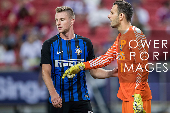 FC Internazionale Goalkeeper Samir Handanovic (R) talks to FC Internazionale Defender Milan Skriniar (L) during the International Champions Cup match between FC Bayern and FC Internazionale at National Stadium on July 27, 2017 in Singapore. Photo by Marcio Rodrigo Machado / Power Sport Images