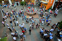 Event photography of Charlotte's Alive After Five weekly happy hour and entertainment celebration at the Charlotte Epicentre. The Epicentre is home to many Charlotte restaurants and bars, including Whisky River, Suite, Vida, Strike City and BlackFinn.