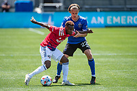 SAN JOSE, CA - APRIL 24: Jader Obrian #7 of FC Dallas fends off Tommy Thompson #22 of the San Jose Earthquakes during a game between FC Dallas and San Jose Earthquakes at PayPal Park on April 24, 2021 in San Jose, California.