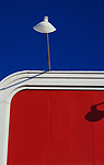 White street lamp over a red billboard with blue skies downtown Seattle Washington State USA