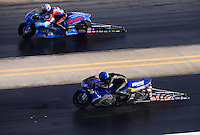 Sept. 14, 2012; Concord, NC, USA: NHRA pro stock motorcycle rider Michael Phillips (near lane) races alongside Chip Ellis during qualifying for the O'Reilly Auto Parts Nationals at zMax Dragway. Mandatory Credit: Mark J. Rebilas-