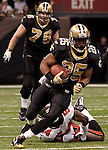 December 2009:  New Orleans Saints running back Reggie Bush (25) runs with the ball during an NFL football game at the Louisiana Superdome in New Orleans.  The Buccaneers defeated the Saints 20-17.