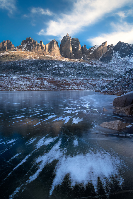 The blowing snow on the frozen surface of Talus Lake, with soft light on Mt. Monolith, shot on a very windy winter day.