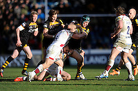 Chris Bell of London Wasps is tackled by Dan Braid of Sale Sharks during the Aviva Premiership match between London Wasps and Sale Sharks at Adams Park on Saturday 1st March 2014 (Photo by Rob Munro)