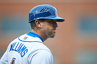 Durham Bulls manager Brady Williams (4) coaches third base during the game against the Gwinnett Braves at Durham Bulls Athletic Park on April 20, 2019 in Durham, North Carolina. The Bulls defeated the Braves 11-3 in game one of a double-header. (Brian Westerholt/Four Seam Images)