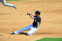 New York Yankees outfielder Slade Heathcott #92 slides into second during a Spring Training game against the Toronto Blue Jays at Steinbrenner Field on February 28, 2013 in Tampa, Florida.  Toronto defeated New York 1-0.  (Mike Janes/Four Seam Images)